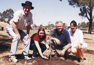 Planting trees with friends to support recognition of Brain Injury Awareness